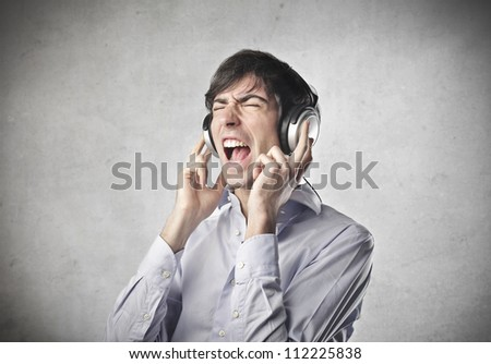 Boy listening to music with earphones - stock photo