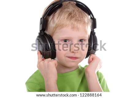 boy listening to music with headphones