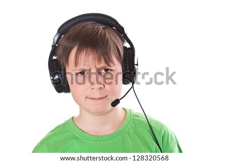 Boy listening to music with headphones on white background - stock photo