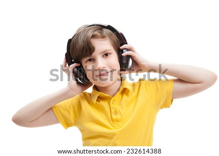 Boy listens music with headphones, isolated on white background - stock photo