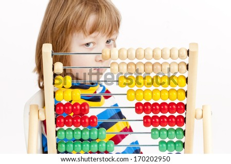 Boy Looking at Colorful Wooden Abacus Thinking - Isolated on White - stock photo