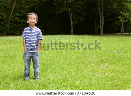 Boy looking at the camera on park