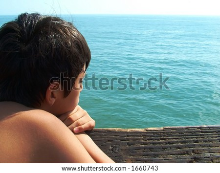Boy Looking out at the Sea - stock photo