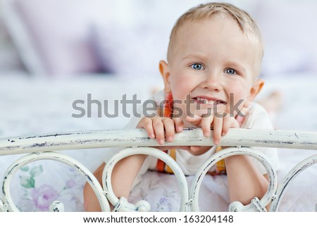 boy lying on the bed - stock photo
