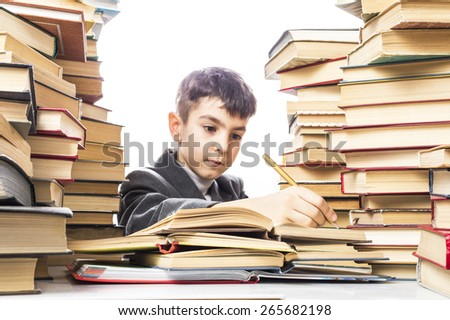 boy makes a mark in an open book - stock photo