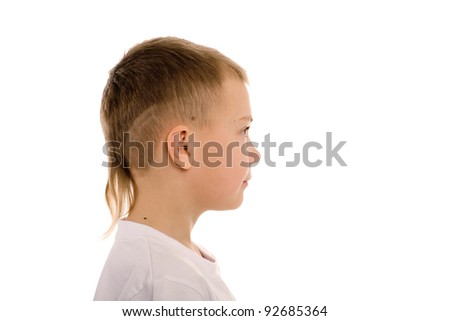 Boy of eight years in profile. Children's hairdo - a series of five photos.