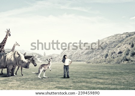 Boy of school age outdoor with wild animals