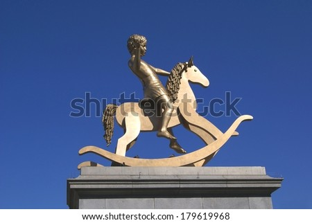 boy on a rocking horse statue, Trafalgar Square, London, England - stock photo