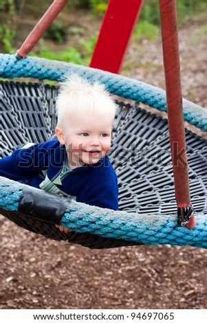 Boy on a swing - stock photo