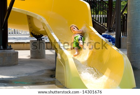 Boy on a Water Slide - stock photo