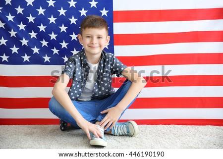 Boy on American flag background - stock photo