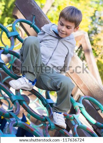 boy on the playground - stock photo