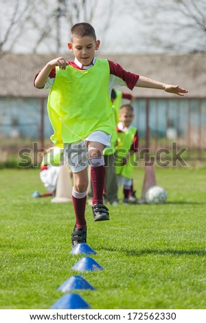 boy on the sports field - stock photo