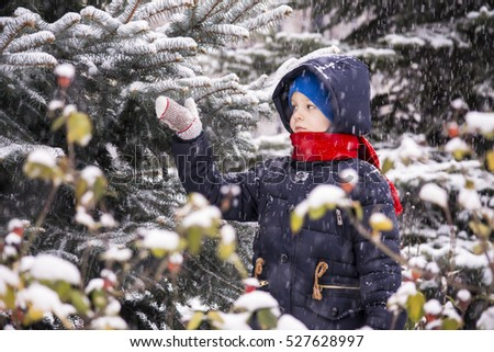 boy outdoors in the winter snow