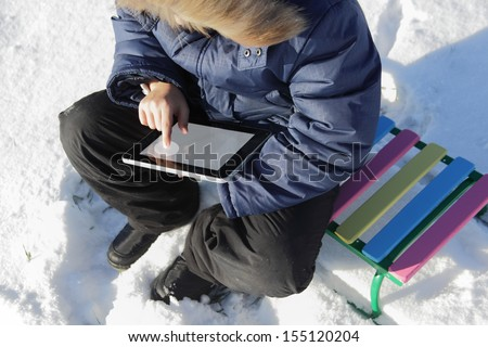 boy outdoors with tablet PC - stock photo