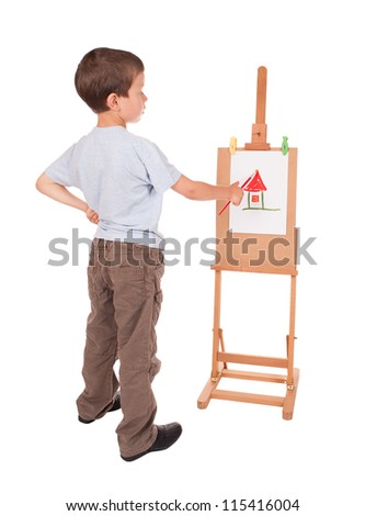 boy paints house on easel - stock photo