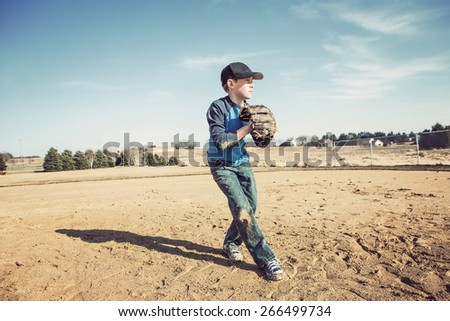 Boy pitching a baseball - stock photo
