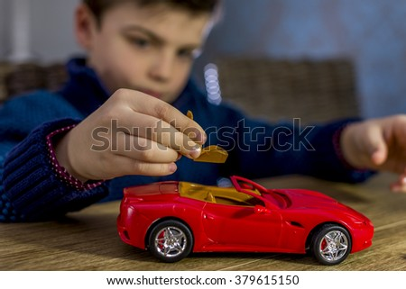 boy placing seat in a model car kit