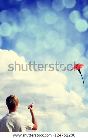 Boy play with fly kite. - stock photo