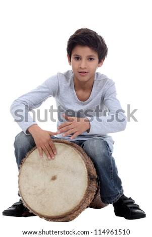 Boy playing a djembe - stock photo