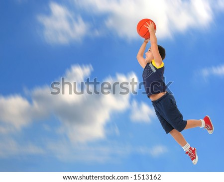 Boy playing basketball jumping and flying. Blue sky. From my sport series. - stock photo