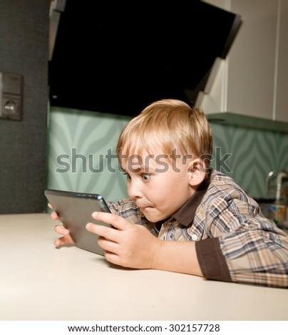 boy playing computer - stock photo