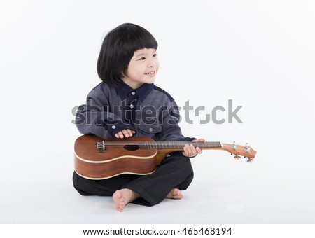 Boy playing guitar on white background