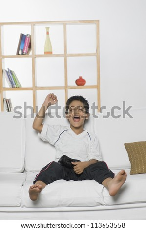 Boy playing handheld video game