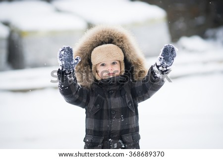 boy playing in the snow. Cold snowy winter. Happy childhood