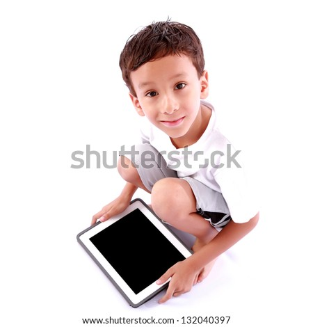 Boy playing on tablet over white background
