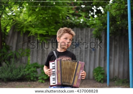 boy playing the accordion - stock photo