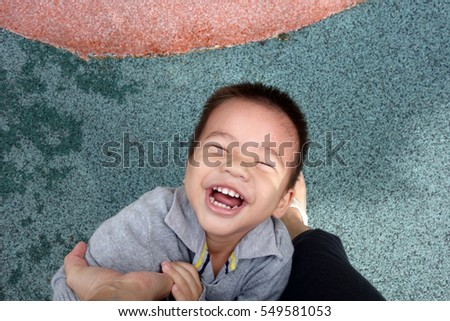 Boy playing upside down