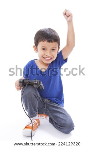 Boy playing video game  - stock photo