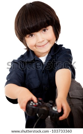 Boy playing video games and holding a control - isolated over a white background