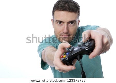boy playing with a joypad isolated on white background - stock photo