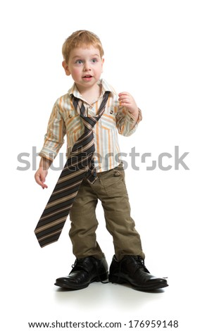 boy playing with big father's shoes isolated - stock photo