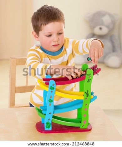 boy playing with cars.The concept of child development, education, recreation