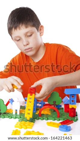 boy playing with color toy isolated on white background