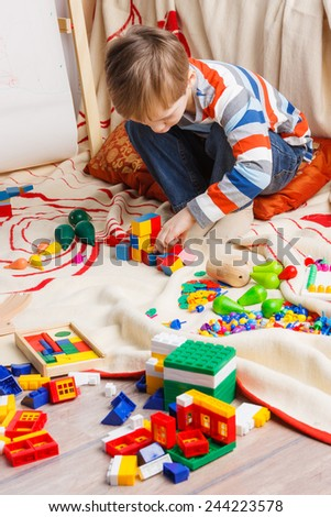 Boy playing with different toys