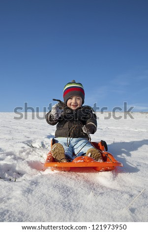 boy playing with the snow during the holidays - stock photo