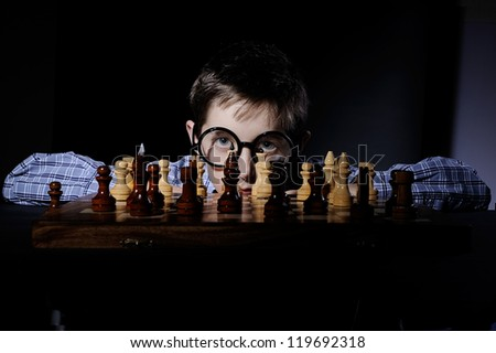 boy plays chess - stock photo