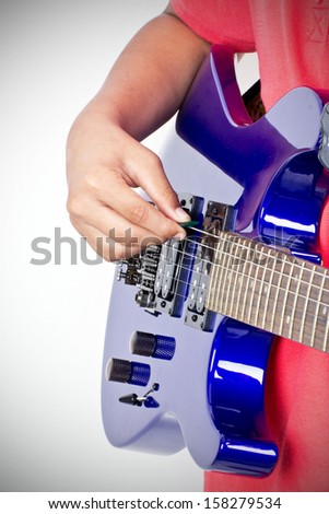 boy  plays on the electric guitar - stock photo