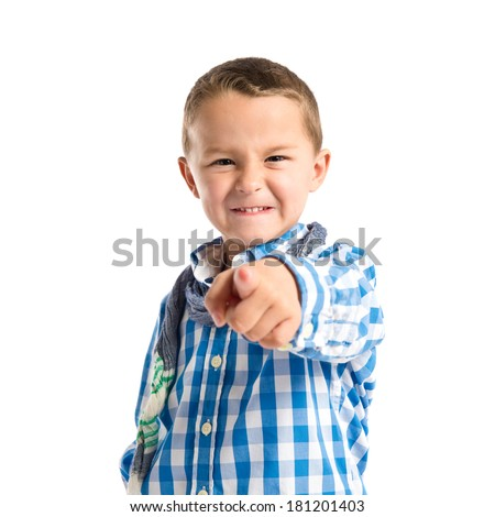 Boy pointing to the front over white background