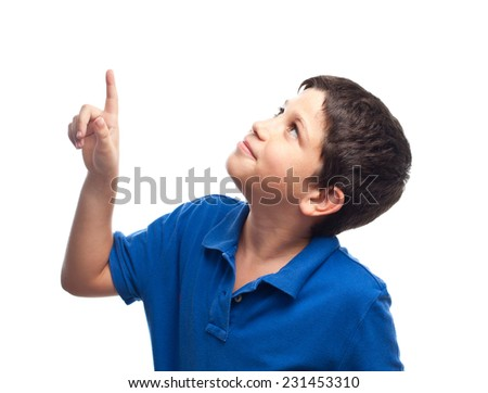 boy pointing up - stock photo