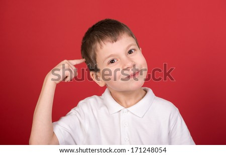 boy portrait in white shirt on red