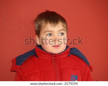 boy portrait red isolated - stock photo