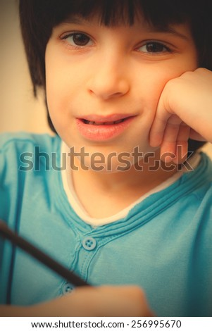 boy portrait with pen, close up. instagram image retro style - stock photo