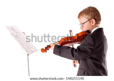 Boy Practicing Violin At Home  - stock photo