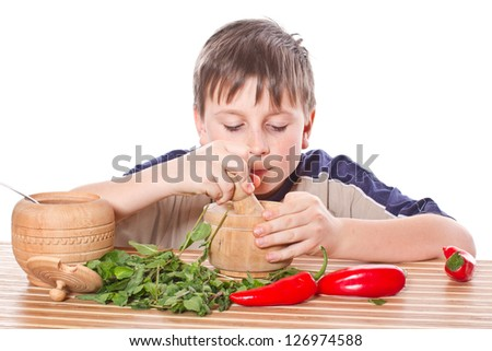 Boy preparing breakfast on a white background - stock photo