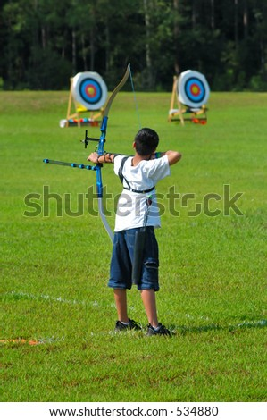Boy pulling a bow - stock photo